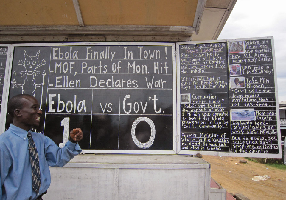 Photo - Social Commentator Alfred Sirleaf,  gives comment on current events in Liberia including the deadly Ebola virus by speaking and writhing them down on a blackboard in Monrovia, Liberia, Thursday, July 31, 2014. The worst recorded Ebola outbreak in history surpassed 700 deaths in West Africa as the World Health Organization on Thursday announced dozens of new fatalities. (AP Photo/Jonathan Paye-Layleh)