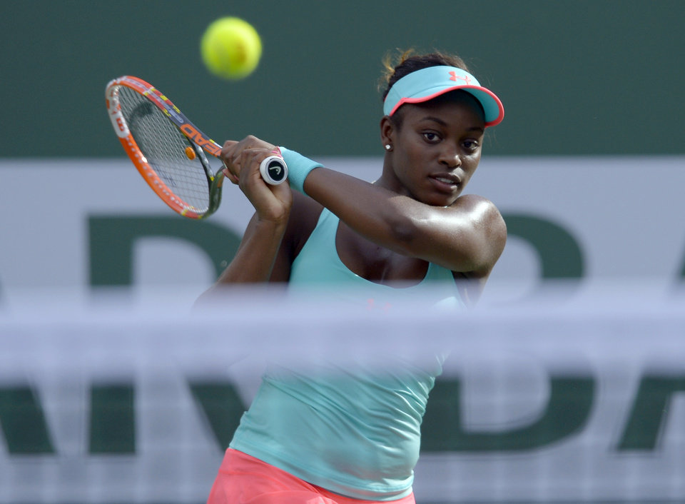 Photo - Sloane Stephens hits to Flavia Pennetta, of Italy, during a quarterfinal match at the BNP Paribas Open tennis tournament Thursday, March 13, 2014, in Indian Wells, Calif. (AP Photo/Mark J. Terrill)