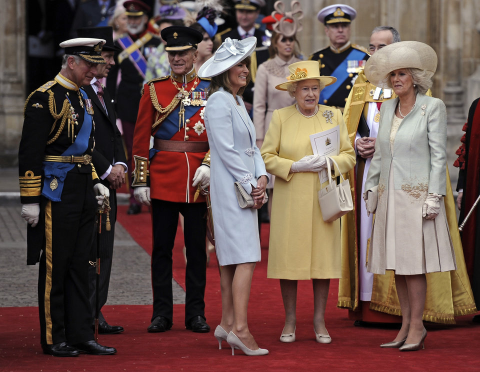 Photo - From left, Prince Charles, Prince Phillip, Carole Middleton, Britain's Queen Elizabeth II and Camilla, Duchess of Cornwall stand outside of Westminster Abbey after the Royal Wedding in London Friday, April, 29, 2011. (AP Photo/Martin Meissner) ORG XMIT: RWMG159