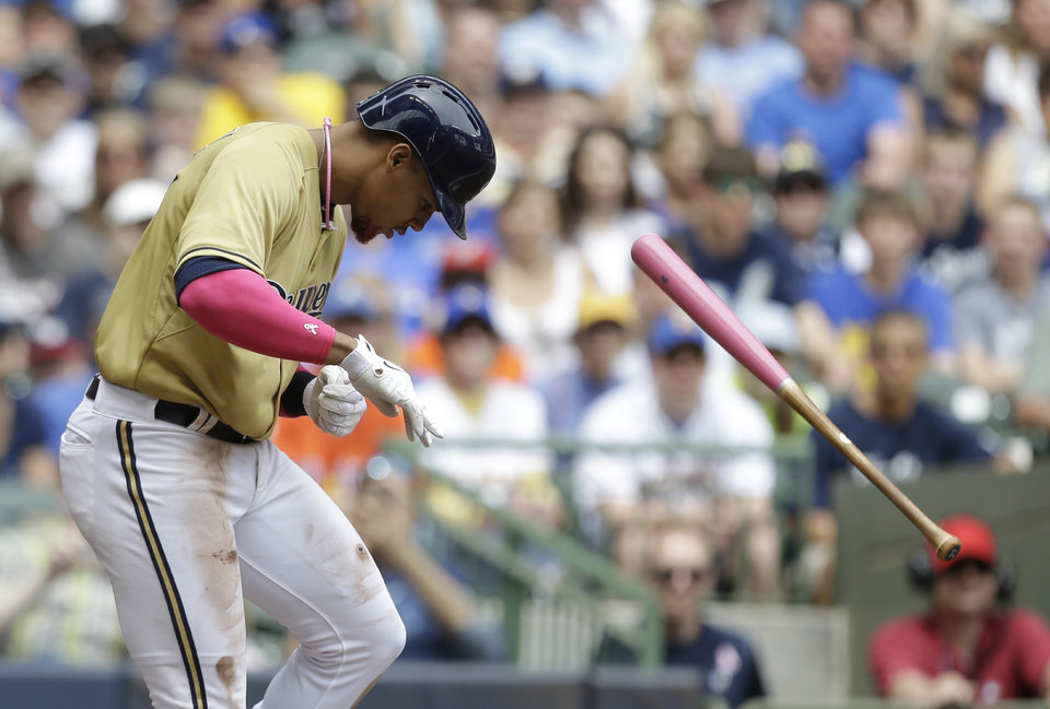 Photo - Milwaukee Brewers' Carlos Gomez reacts after getting hit by a pitch by the New York Yankees in the third inning of a baseball game Sunday, May 11, 2014, in Milwaukee. (AP Photo/Jeffrey Phelps)