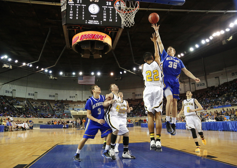 Photo - Glencoe starter Ty Lazenby delivers a lay-up over Kiowa defender Shay Calvert during Class A boys high school basketball championship game in the Jim Norick Arena at State Fair Park on  Saturday, March 8, 2014. Glencoe defeated Kiowa, 57-39. Photo by Jim Beckel, The Oklahoman