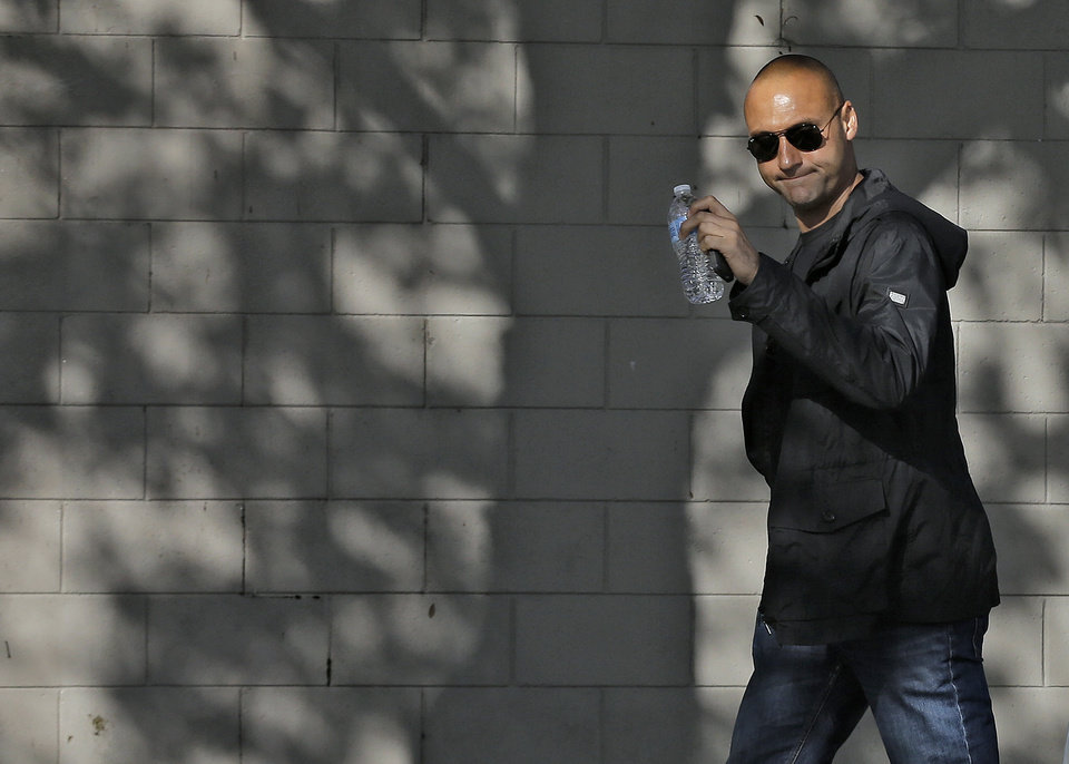 Photo - New York Yankees shortstop Derek Jeter waves as he arrives to workout at the baseball team's minor league facility  Thursday, Feb. 13, 2014, in Tampa, Fla. Jeter announced that he is retiring at the end of the 2014 season. (AP Photo/Chris O'Meara)