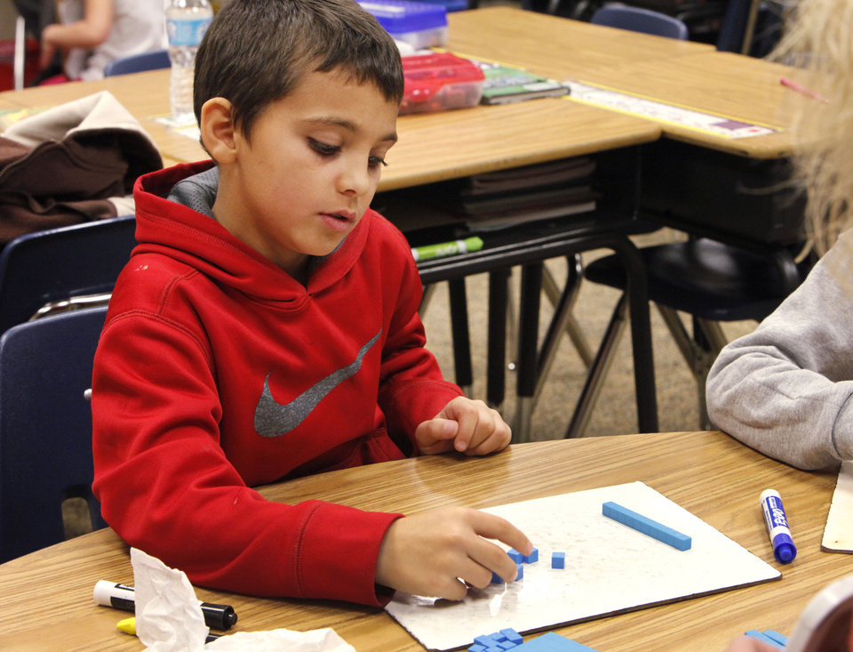Second grader Kabl Kahkesh works on a math lesson at Centennial Elementary School in Edmond.  Photo By David McDaniel/The Oklahoman <strong>David McDaniel - The Oklahoman</strong>