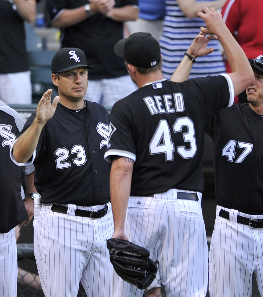 Photo - Chicago White Sox manager Robin Ventura (23) celebrates with closing pitcher Addison Reed (43) after defeating the Atlanta Braves 10-6 in an interleague baseball game in Chicago, Saturday, July 20, 2013. (AP Photo/Paul Beaty)