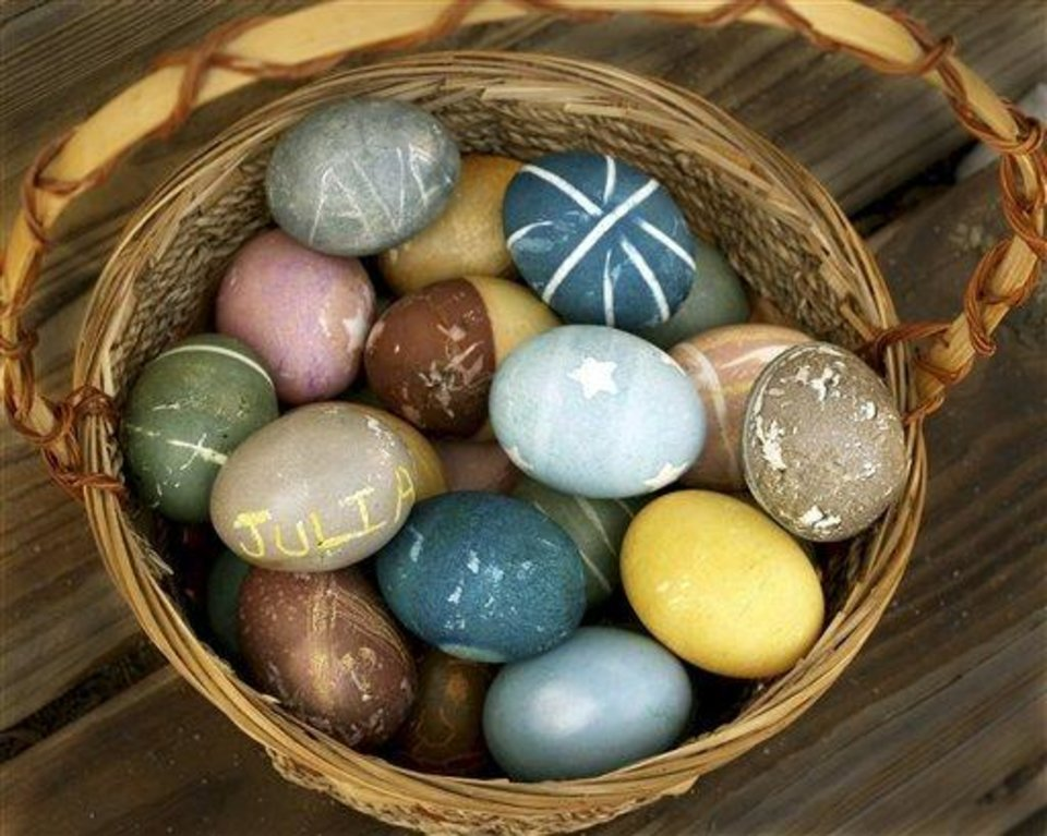 Photo - This undated image courtesy of Amy Gates shows a basket full of eggs dyed by Gates, of Longmont, Colo., which appears on her blog, Crunchy Domestic Goddess.  Gates dyes her eggs with foods and spices. It's healthier, she maintains, and fun, like a science project.   (AP Photo/Amy Gates)