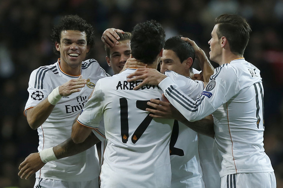 Photo - Real's Angel Di Maria, second left, celebrates his goal with team mates during a Champions League Group B soccer match between Real Madrid and Galatasaray, at the Santiago Bernabeu stadium in Madrid, Wednesday, Nov. 27, 2013. (AP Photo/Andres Kudacki)