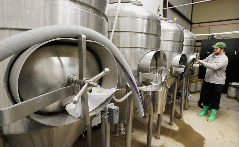 Photo - Chase Healey, head brewer, with the 217 gallon brewery tanks at Coop Ale Works in Oklahoma City Monday, Feb. 2, 2009. BY PAUL B. SOUTHERLAND, THE OKLAHOMAN ORG XMIT: KOD
