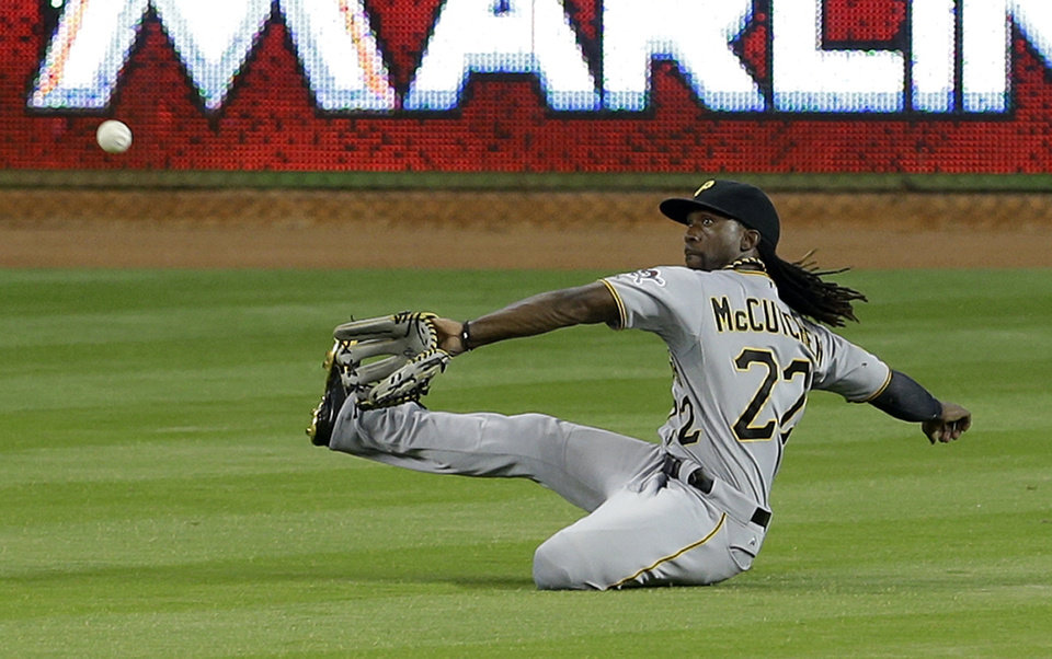 Photo - Pittsburgh Pirates center fielder Andrew McCutchen prepares to catch a line drive by Miami Marlins' Rafael Furcal in the fifth inning of a baseball game in Miami, Saturday, June 14, 2014. (AP Photo/Alan Diaz)