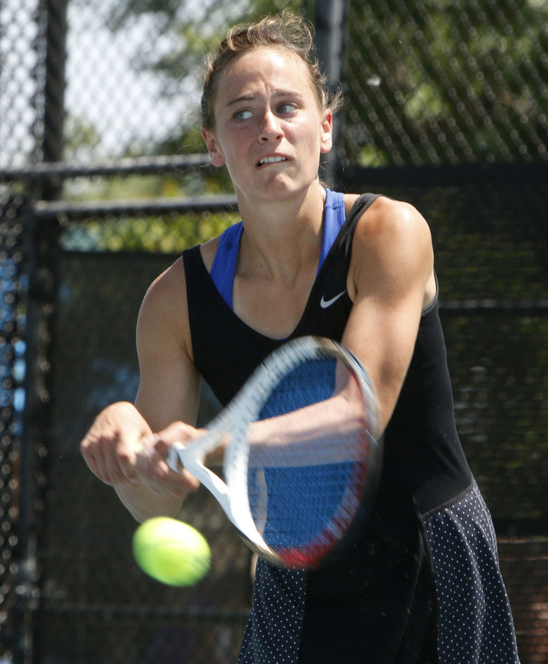 Photo - Deer Creek's Kelsi Williams plays her 5A semi-final match against Duncan's Alex Bowers during the Girl's State Tennis Tournament at the OKC Tennis Center in Oklahoma City, OK, Saturday, May 10, 2014,  Photo by Paul Hellstern, The Oklahoman