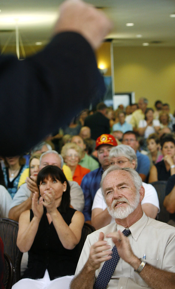 Photo - The lobby of Chase Bank in downtown Oklahoma City was crammed with more than 500 people who came to hear US Sen. Tom Coburn at a town hall meeting Monday afternoon, Aug. 24, 2009.  Photo by Jim Beckel, The Oklahoman