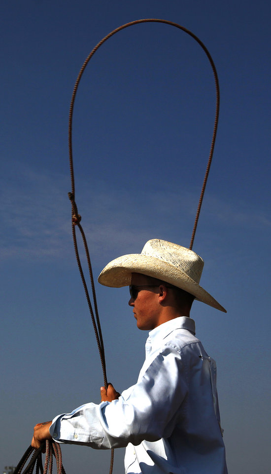 Audy Reed of Spearman Texas warms up before the team roping event during day four of the International Youth Finals Rodeo at the Shawnee Expo Center in Shawnee, Okla, Wednesday, July 11, 2012. Photo by Sarah Phipps, The Oklahoman