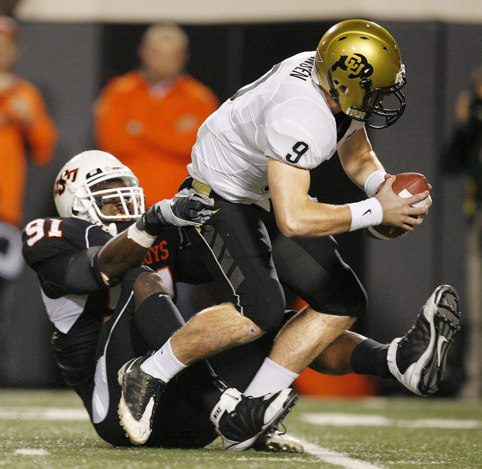 Photo - OSU's Ugo Chinasa sacks Colorado quarterback Tyler Hansen in the first quarter. Photo by Nate Billings, The Oklahoman