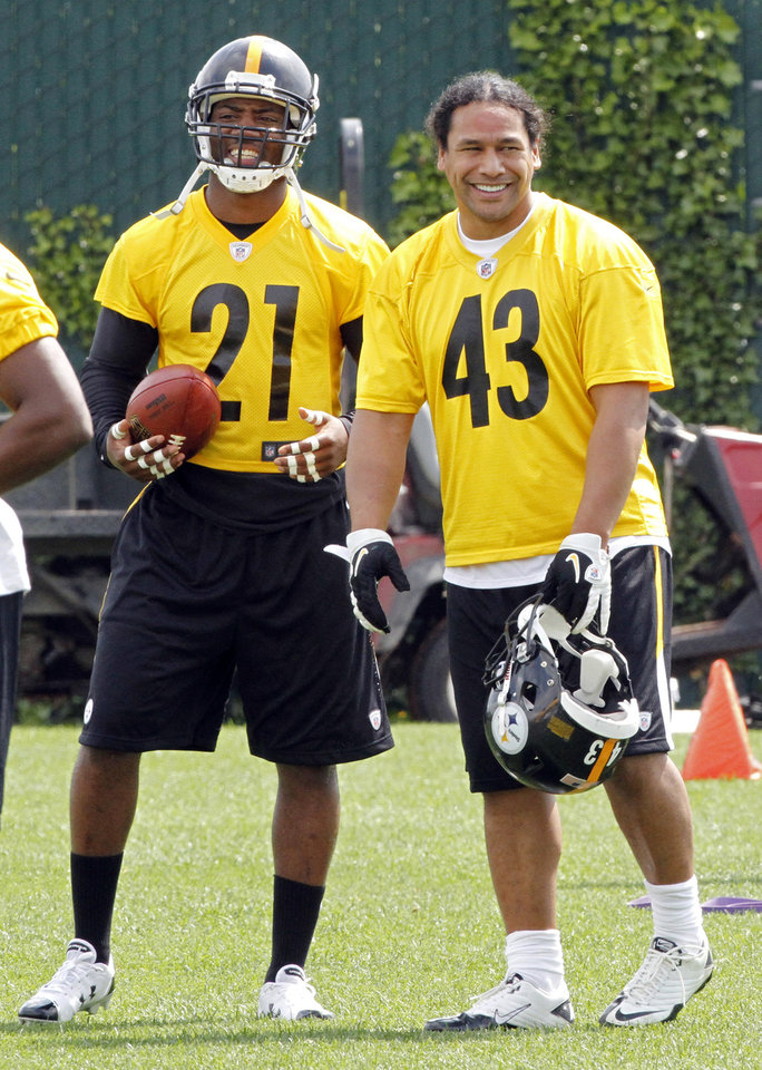 Photo -   Pittsburgh Steeelrs safeties Troy Polalmalu, right, and Ryan Clark share a laugh during the first day of NFL football practice at the team's training facility on Tuesday, May 22, 2012 in Pittsburgh. (AP Photo/Keith Srakocic)