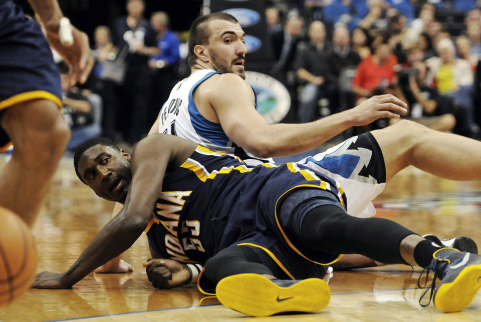 Indiana Pacers' Roy Hibbert, left, and Minnesota Timberwolves' Nikola Pekovic, of Montenegro, watch the loose ball after colliding in the first half of an NBA basketball game, Friday, Nov. 9, 2012, in Minneapolis. (AP Photo/Jim Mone)