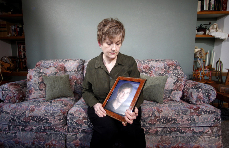 Photo - FILE – In this Monday, Feb. 27, 2012 file photo, Karen Williams, who sued Facebook for access to her 22-year-old son Loren's account after he died in a 2005 motorcycle accident, looks at a portrait of her son at her home in Beaverton, Ore. The Uniform Law Commission on Wednesday, July 16, 2014 was expected to endorse a plan to automatically give loved ones access to — but not control of — all digital accounts, unless otherwise specified.  (AP Photo/Rick Bowmer, File)