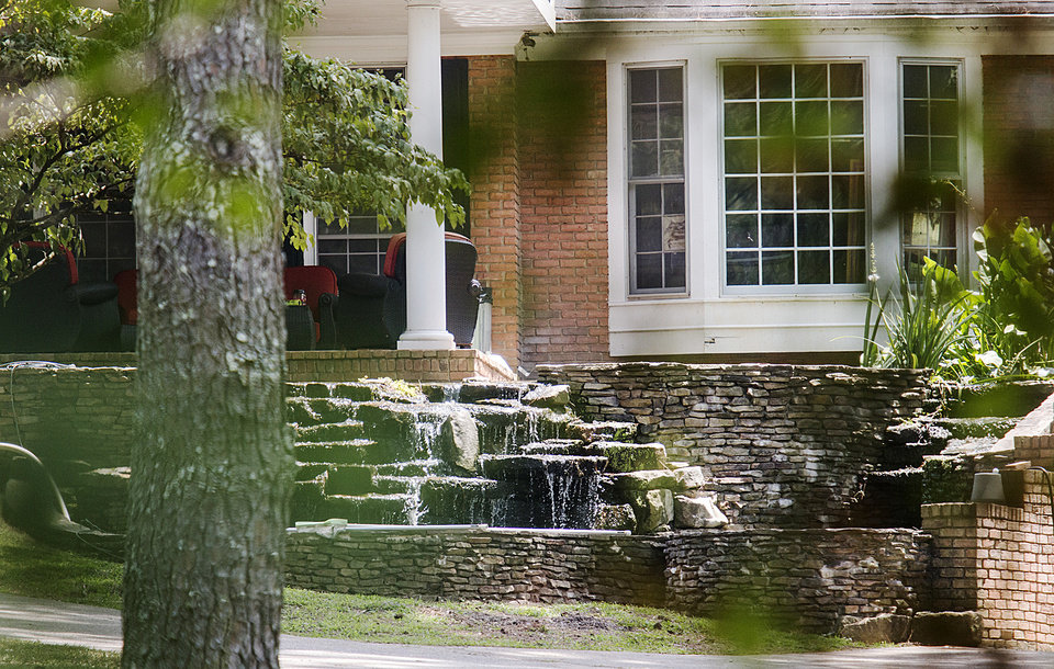 Photo - The house where bar owner Dean Riopelle overdosed Sept. 17, 2013, while at home with his girlfriend, Alix Tichelman, stands Thursday, July 10, 2014, in Milton, Ga. Two months before police say Tichelman, a high-priced prostitute, calmly left a Google executive dying from a heroin overdose on his yacht, the woman panicked on the phone with a 911 dispatcher as her boyfriend lay on the floor of their home in the throes of a fatal overdose. Police said Thursday they are re-examining the death if Riopelle, 53, the owner of a popular Atlanta music venue. Riopelle had been dating Tichelman, who is now charged with manslaughter in the November death of Google executive Forrest Hayes. She was never charged in Riopelle's death. (AP Photo/Ron Harris)