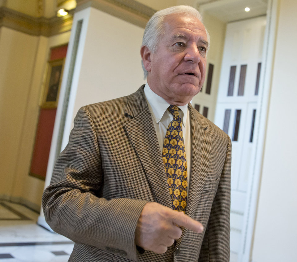 Photo - In this Nov. 15, 2013, photo, Rep. Nick Rahall, D-W.Va., walks on on Capitol Hill in Washington, Friday, Nov. 15, 2013. In his West Virginia district, the TV ads attacking Rahall over the calamitous startup of President Barack Obama's health care law have already begun. The 19-term veteran, a perennial target in a GOP-shifting state, is among many in the president's party who have recited to constituents Obama's assurance that they could keep insurance coverage they liked under the 2010 overhaul.  (AP Photo/J. Scott Applewhite)