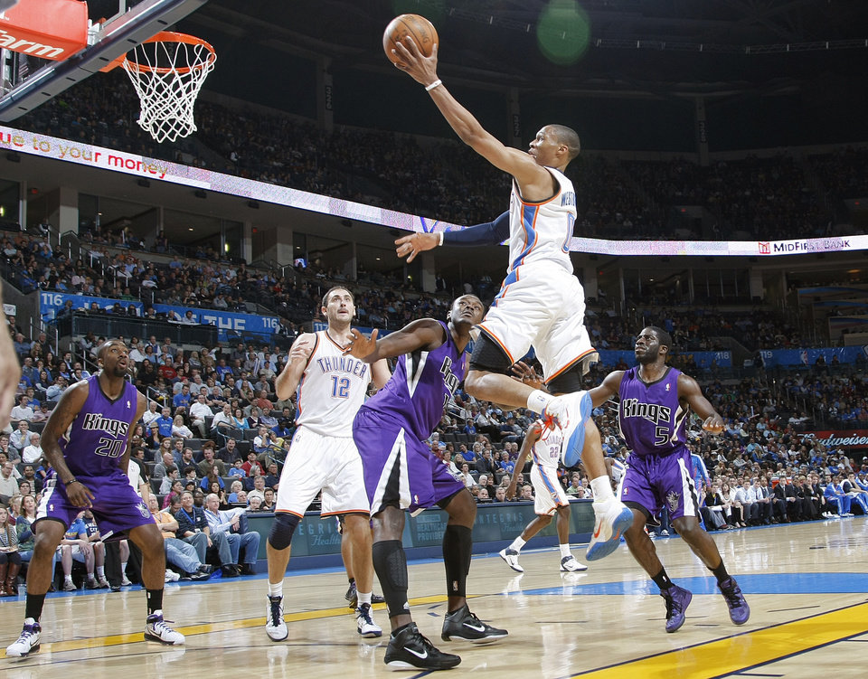The Thunder\'s Russell Westbrook (0) drives to the basket past the Kings\' defense during the NBA basketball game between the Oklahoma City Thunder and The Sacramento Kings on Tuesday, Feb. 15, 2011, Oklahoma City Okla. Photo by Chris Landsberger, The Oklahoman ORG XMIT: KOD