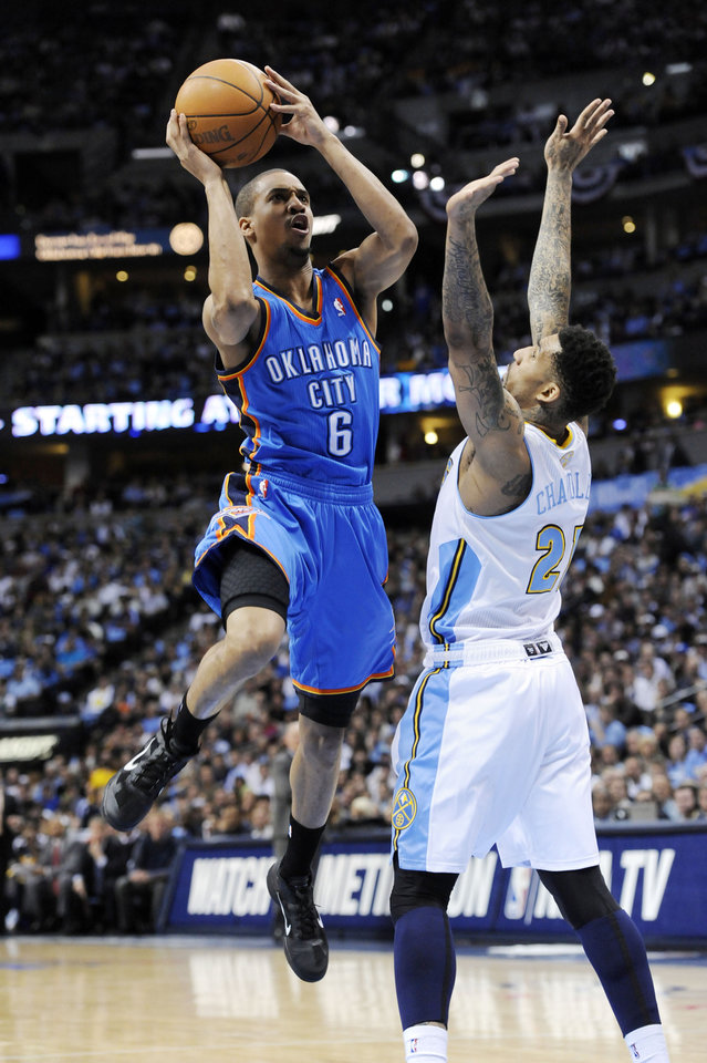 Photo - Oklahoma City Thunder guard Eric Maynor (6) shoots against Denver Nuggets forward Wilson Chandler (21) during the first half in game 4 of a first-round NBA basketball playoff series Monday, April 25, 2011, in Denver. (AP Photo/Jack Dempsey)