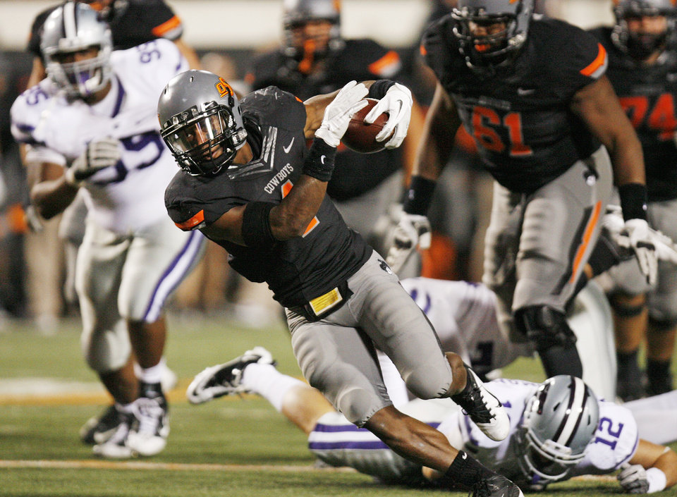 Photo - OSU's Joseph Randle (1) breaks away from the Kansas State defense for OSU's final touchdown in the fourth quarter during a college football game between the Oklahoma State University Cowboys (OSU) and the Kansas State University Wildcats (KSU) at Boone Pickens Stadium in Stillwater, Okla., Saturday, Nov. 5, 2011. OSU won, 52-45. Photo by Nate Billings, The Oklahoman