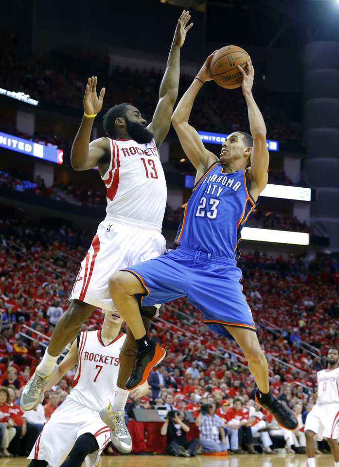 Oklahoma City's Kevin Martin drives to the basket beside Houston's James Harden during Game 6 in the first round of the NBA playoffs between the Oklahoma City Thunder and the Houston Rockets at the Toyota Center in Houston, Texas, Friday, May 3, 2013. Photo by Bryan Terry, The Oklahoman