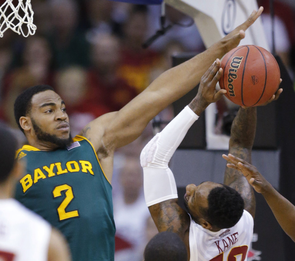 Photo - Iowa State guard DeAndre Kane, right, is fouled by Baylor forward Rico Gathers (2) during the first half of an NCAA college basketball game in the final of the Big 12 Conference men's tournament in Kansas City, Mo., Saturday, March 15, 2014. (AP Photo/Orlin Wagner)