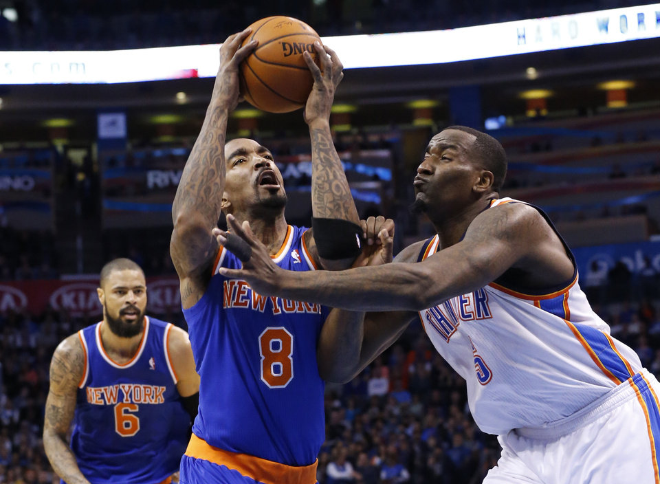 Photo - New York Knicks guard J.R. Smith (8) is fouled by Oklahoma City Thunder center Kendrick Perkins (5) in the second quarter of an NBA basketball game in Oklahoma City, Sunday, Feb. 9, 2014. (AP Photo/Sue Ogrocki)