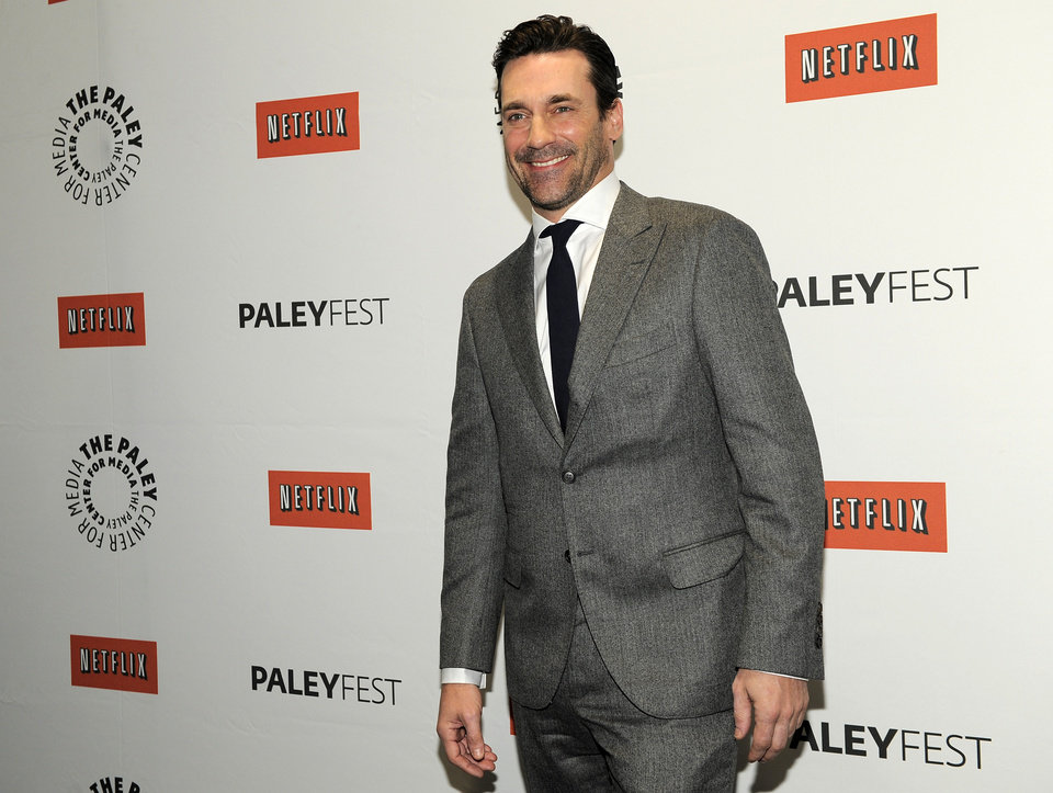 "FILE - In this March 13, 2012 file photo, Jon Hamm, a cast member in the television series ""Mad Men,"" poses before the PaleyFest 2012 panel discussion about the show, in Beverly Hills, Calif. Hamm is going mad over Justin Timberlake's suit and tie, the song and the singer's style. The 42-year-old actor, who admitted to having an ""appreciation for fashion,"" returns as womanizing ad man Don Draper when season six premieres April 7, 2013 on AMC. (AP Photo/Chris Pizzello, File)"