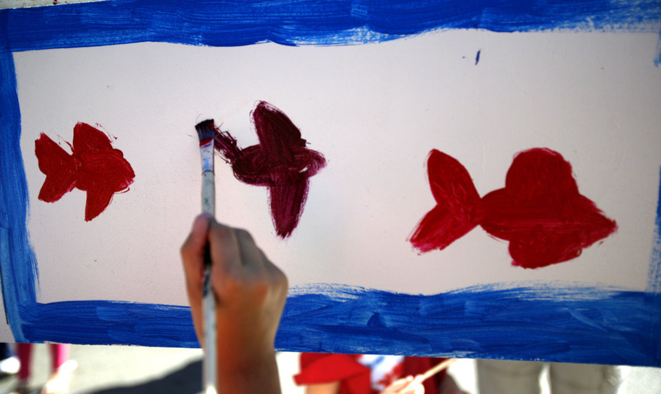 A child paints during the 2011 Plaza District Festival in Oklahoma City. Photo by Sarah Phipps, The Oklahoman Archives <strong>SARAH PHIPPS - SARAH PHIPPS</strong>