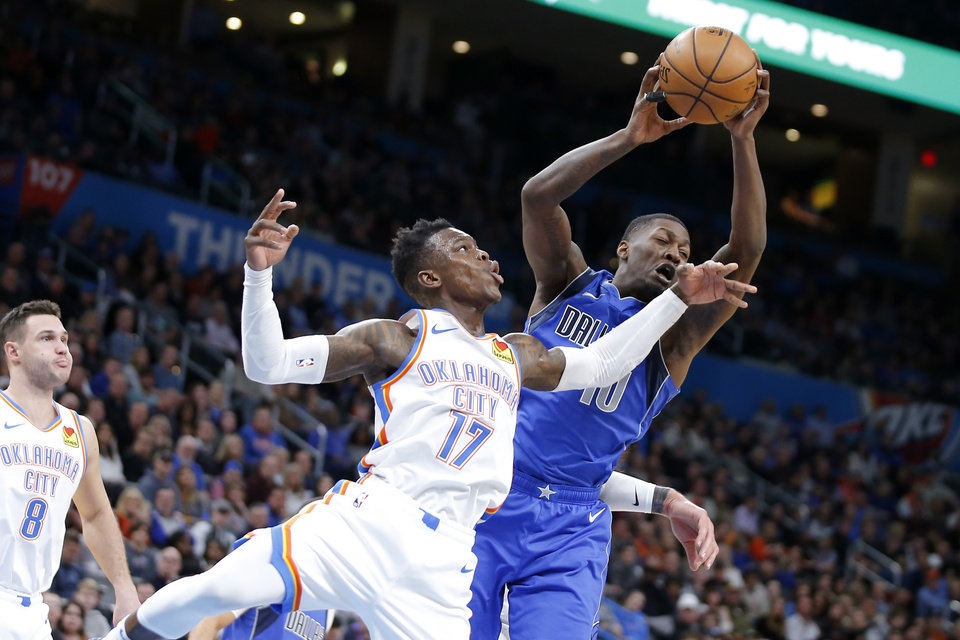 Photo - Oklahoma City's Dennis Schroder (17) goes for the ball beside Dorian Finney-Smith (10) of Dallas during an NBA basketball game between the Oklahoma City Thunder and the Dallas Mavericks at Chesapeake Energy Arena in Oklahoma City, Tuesday, Dec. 31, 2019. Oklahoma City won 106-101. [Bryan Terry/The Oklahoman]