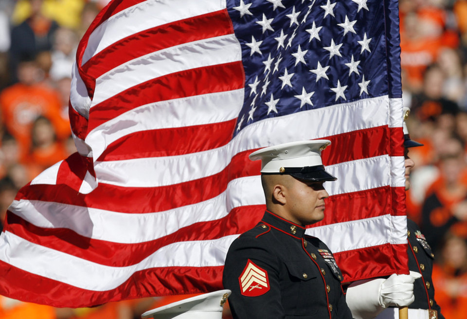 The U.S. Marines present the flag during the college football game between the Oklahoma State University Cowboys (OSU) and the Baylor University Bears at Boone Pickens Stadium in Stillwater, Okla., Saturday, Nov. 6, 2010. Photo by Sarah Phipps, The Oklahoman