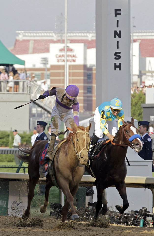 Photo - Jockey Mario Gutierrez rides I'll Have Another to victory past Bodemeister ridden by Mike Smith (6) to victory in the 138th Kentucky Derby horse race at Churchill Downs Saturday, May 5, 2012, in Louisville, Ky. (AP Photo/Michael Conroy)  ORG XMIT: DBY178