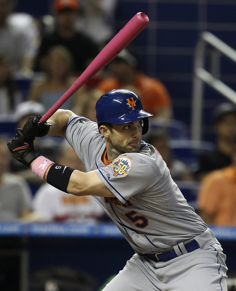 Photo -   New York Mets batter David Wright bats in the fourth inning where he hit a single during a baseball game aganst the Miami Marlins in Miami, Sunday, May 13, 2012. Several players including Wright used pink bats on Mother's Day in celebration of mothers and in support of breast cancer research. (AP Photo/J Pat Carter)