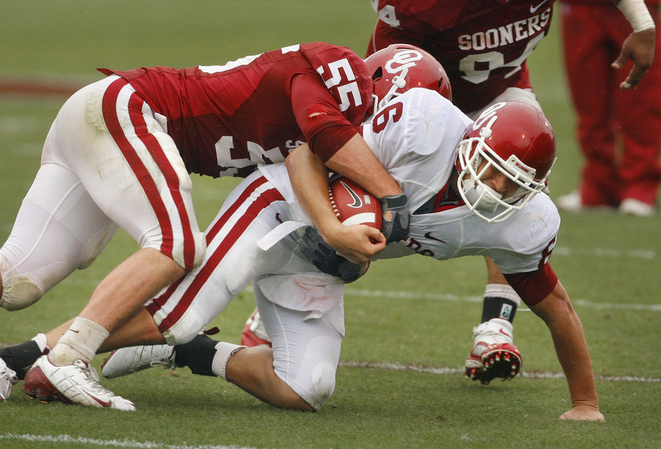 Photo - Cameron Kenney (6) is brought down by Jaydan Bird (55) during the spring Red and White football game for the University of Oklahoma (OU) Sooners at Gaylord Family/Oklahoma Memorial Stadium on Saturday, April 17, 2010, in Norman, Okla.  Photo by Steve Sisney, The Oklahoman