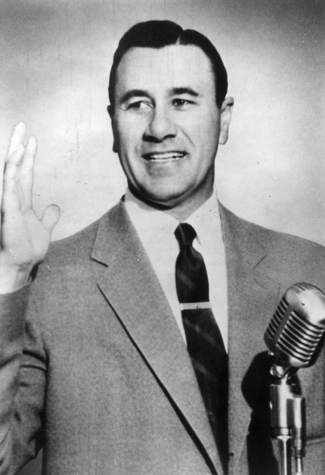 Photo - Tulsa evangelist Oral Roberts behind the microphone in this photo with library date of 9/28/56.