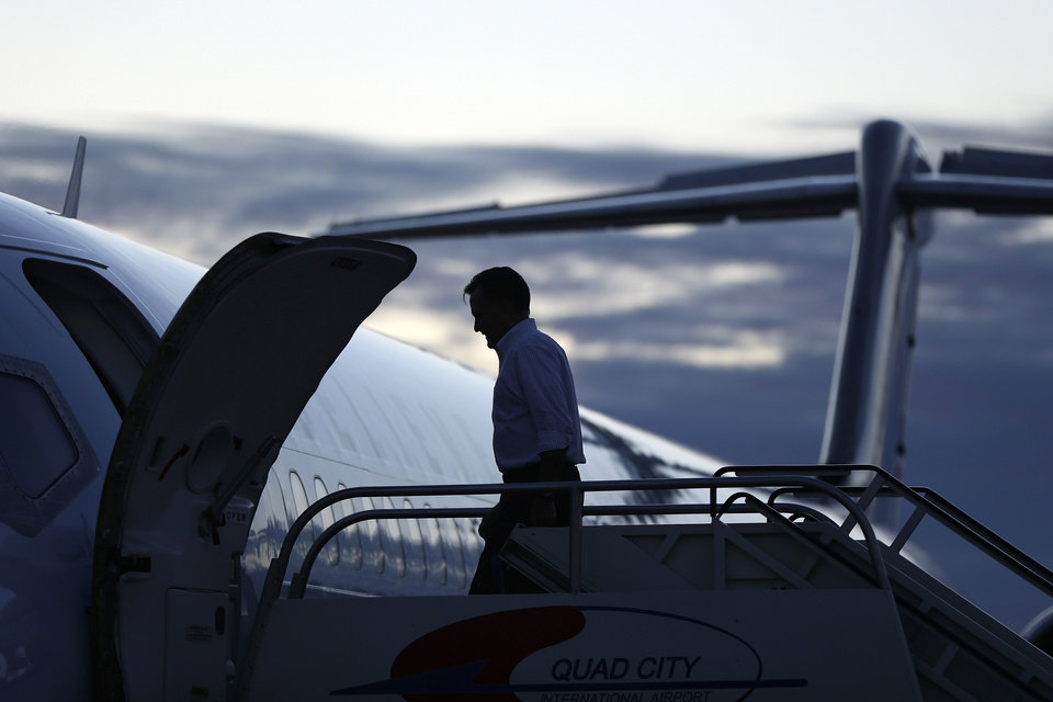 Republican presidential candidate and former Massachusetts Gov. Mitt Romney boards his campaign plane in Moline, Ill., as he travels to Dayton, Ohio, Monday, Oct. 29, 2012. (AP Photo/Charles Dharapak)