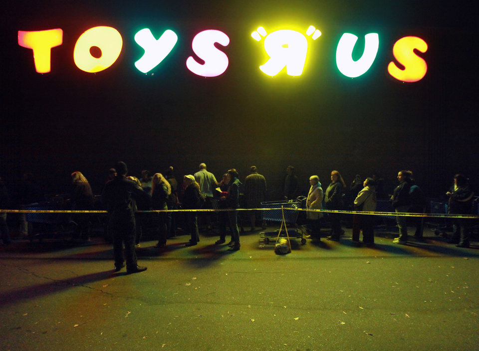 "A line forms outside of Toys ""R"" Us formed before its opening at 8 p.m. as shoppers took advantage of the sales and deals in the earlier shopping period for the typical ""Black Friday"" event on Thursday evening, Nov. 22, 2012 in Chico, Calif. (AP Photo/Jason Halley, Chico Enterprise-Record)"
