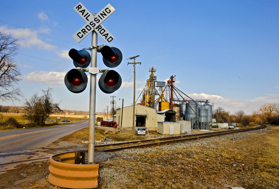 Photo - The railroad tracks behind Luther Mill & Farm Supply are shown Jan. 10, 2014, in Luther. The tracks carry crude oil tankers. Photo by Chris Landsberger, The Oklahoman  CHRIS LANDSBERGER - CHRIS LANDSBERGER
