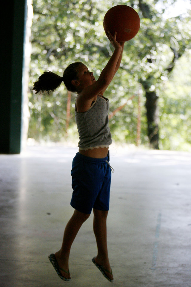 Photo - 11-year-old Shayna Gibson enjoys a game of basketball at Camp Endres, a diabetes camp held at Camp Classen in Davis, OK, Thursday, July 31, 2008. BY PAUL HELLSTERN, THE OKLAHOMAN ORG XMIT: KOD