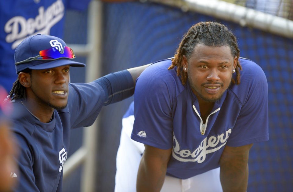 Photo - San Diego Padres' Cameron Maybin, left, talks with Los Angeles Dodgers' Hanley Ramirez during batting practice for a baseball game, Wednesday, Aug. 20, 2014, in Los Angeles.  (AP Photo/Mark J. Terrill)