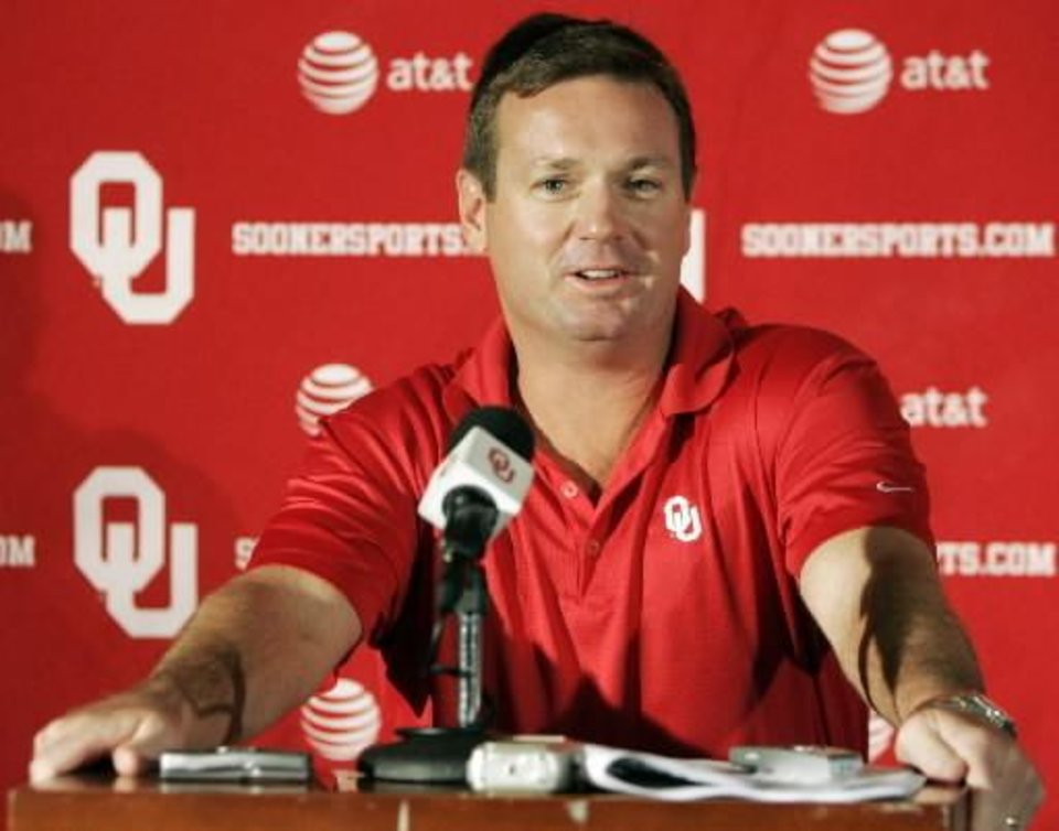 Photo - In this Sept. 23, 2008 AP file photo, Oklahoma football head coach Bob Stoops speaks during a news conference in Norman. Stoops is done with the politicking that has turned the national championship race into a campaign.