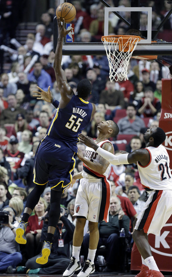 Indiana Pacers center Roy Hibbert, left, shoots over Portland Trail Blazers guard Damian Lillard, middle, and center, J.J. Hickson during the first quarter of an NBA basketball game in Portland, Ore., Wednesday, Jan. 23, 2013.(AP Photo/Don Ryan)