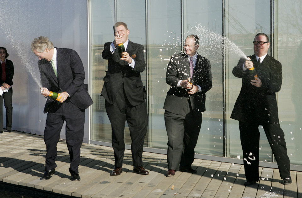 Photo -  From left, Aubrey McClendon, Clayton L. Bennett, Oklahoma City Mayor Mick Cornett and Rand Elliott celebrate the opening of the Chesapeake Boathouse by spraying Champagne Jan. 17, 2006, during a ceremony. [Oklahoman Archives Photos]