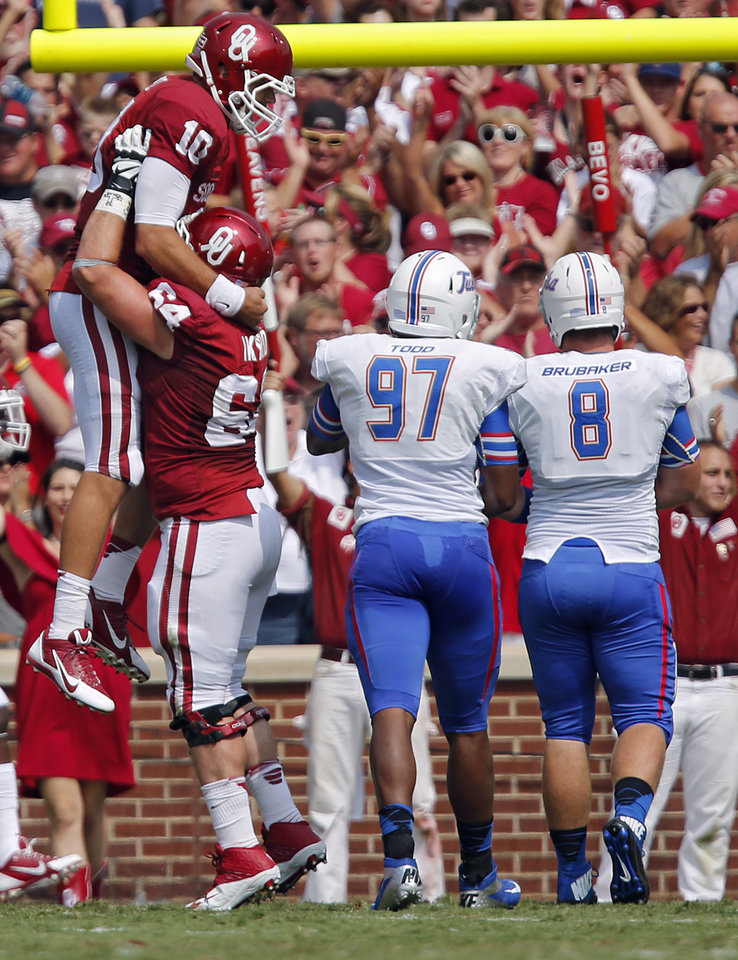 Photo - Oklahoma's Blake Bell (10) and Gabe Ikard (64) celebrate a touchdown during the college football game between the University of Oklahoma Sooners (OU) and the University of Tulsa Hurricanes (TU) at the Gaylord-Family Oklahoma Memorial Stadium on Saturday, Sept. 14, 2013 in Norman, Okla.  Photo by Chris Landsberger, The Oklahoman
