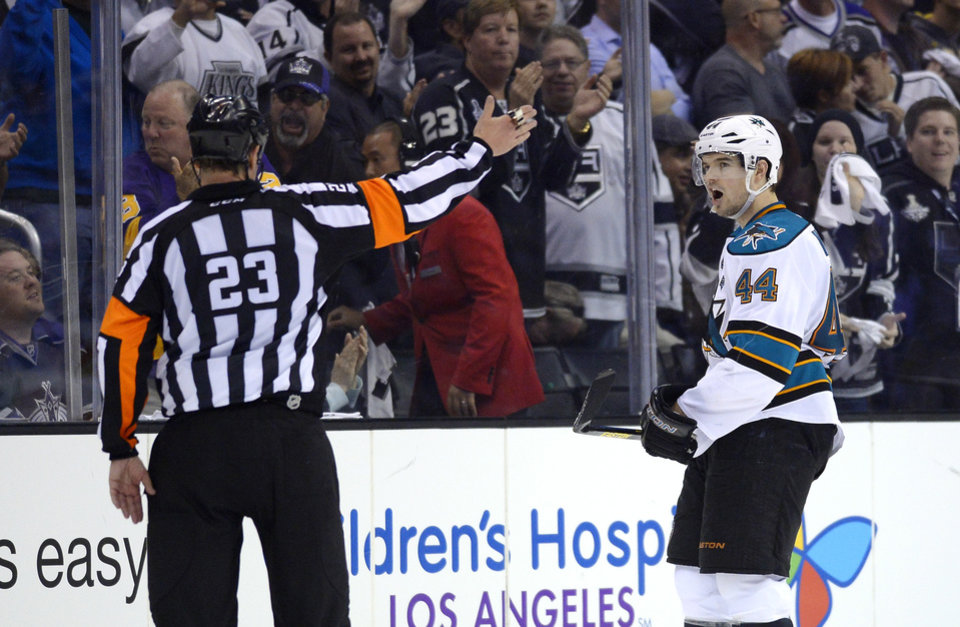 Photo - San Jose Sharks defenseman Marc-Edouard Vlasic, right, complains to referee Brad Watson after being called for a delay of game penalty during the third period in Game 2 of their second-round NHL hockey Stanley Cup playoff series against the Los Angeles Kings, Thursday, May 16, 2013, in Los Angeles.  (AP Photo/Mark J. Terrill)