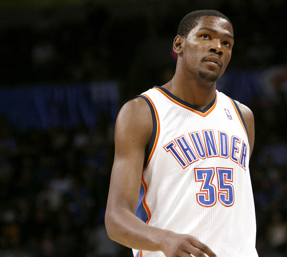 Photo - Oklahoma City's Kevin Durant looks at the scoreboard as he walks off the court during a timeout in the second half of the Thunder's loss to  San Antonio during their NBA basketball game in downtown Oklahoma City  on Sunday, Nov. 14, 2010. The Thunder lost to the Spurs 117-104. Photo by John Clanton, The Oklahoman