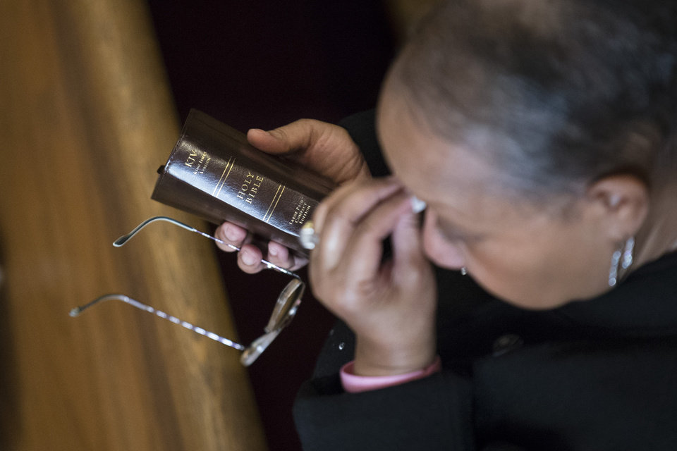 Photo - A parishioner dries her tears during Sunday services at the Bethel Gospel Assembly as the congregation mourns the deaths of two members in Wednesday's explosions in the East Harlem neighborhood of New York, Sunday, March 16, 2014. New York Mayor Bill de Blasio said the women lost