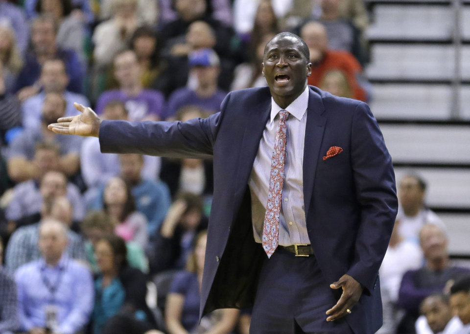 Photo - Utah Jazz coach Tyrone Corbin shouts to his team in the second quarter during an NBA basketball game against the Golden State Warriors Monday, Nov. 18, 2013, in Salt Lake City. (AP Photo/Rick Bowmer)