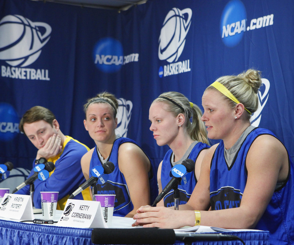 Photo - WOMEN'S NCAA TOURNAMENT / WOMEN'S COLLEGE BASKETBALL / NORMAN REGIONAL: South Dakota State University head coach Aaron Johnston and players Maria Boever, Kristin Rotert, and Ketty Cornemann speak at a press conference for the 2010 NCAA Division 1 Women's Basketball Championship tournament first and second round at the Lloyd Noble Center on Saturday, March 20, 2010, in Norman, Okla.   Photo by Steve Sisney, The Oklahoman ORG XMIT: KOD