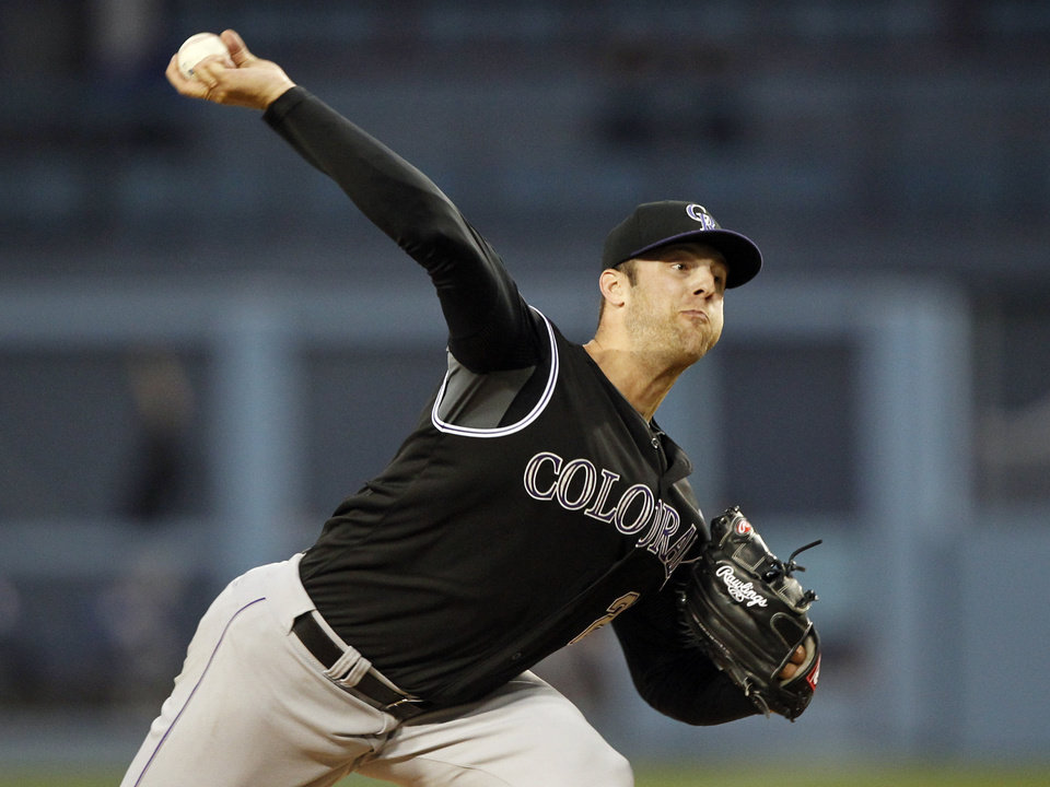 Photo - Colorado Rockies starting pitcher Jordan Lyles throws against the Los Angeles Dodgers in the first inning of a baseball game on Friday, April 25, 2014, in Los Angeles. (AP Photo/Alex Gallardo)